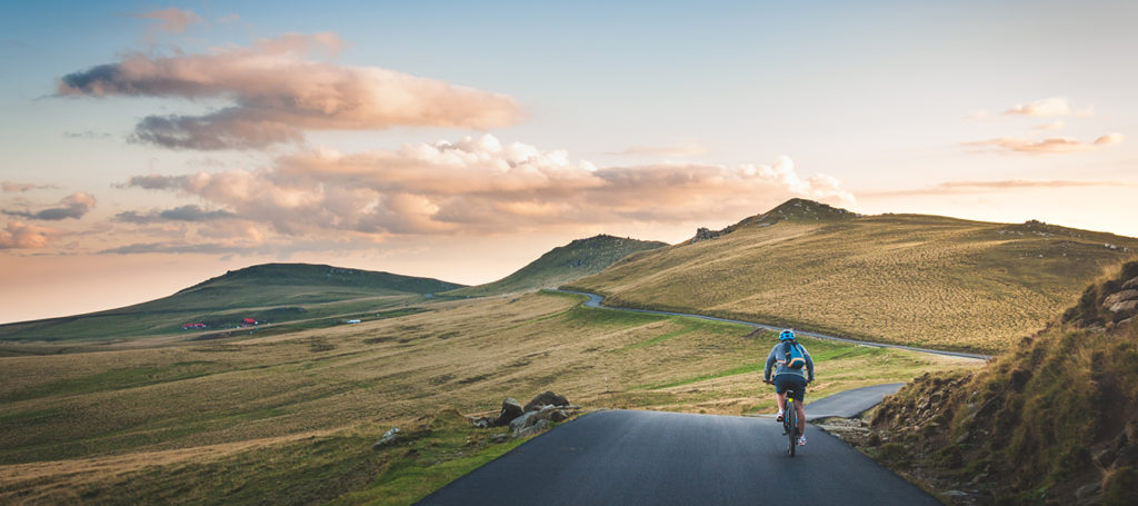 cyclists on a road amidst rolling hills - who would benefit from a glucosamine supplement